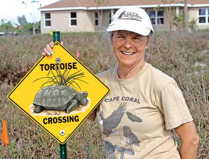 Cheryl posts caution signs to alert drivers